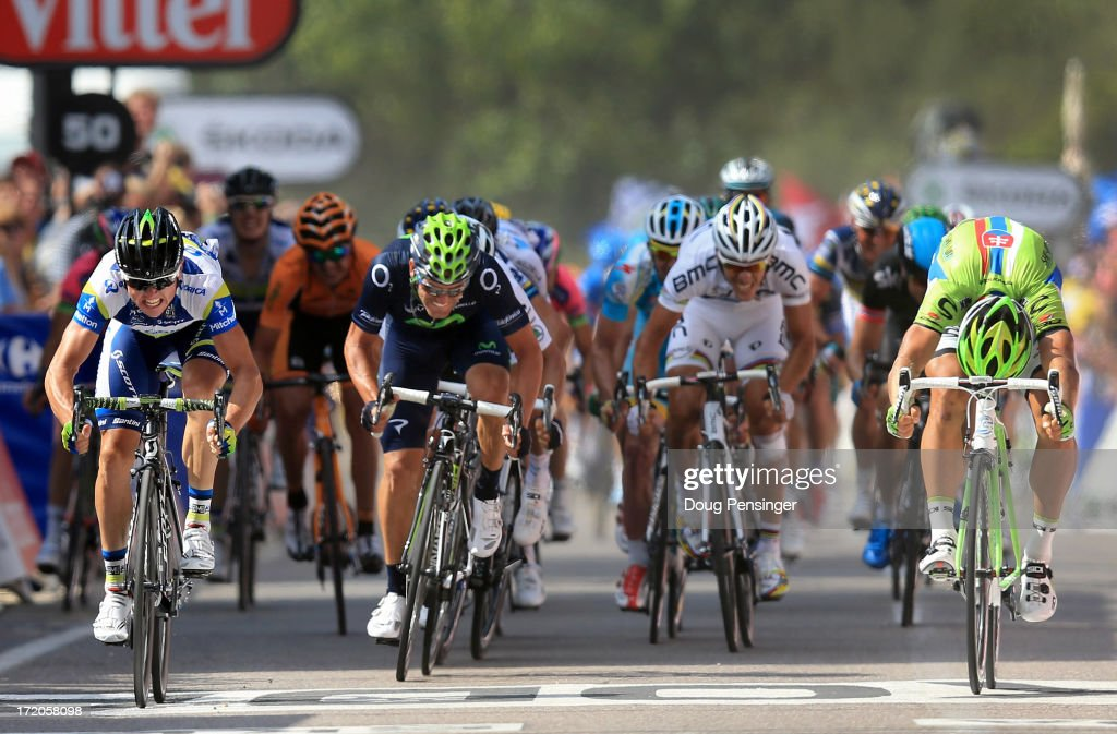 Simon Gerrans (L) of Australia riding for Orica GreenEdge takes the win as he out sprints Peter Sagan (R) of Slovakia riding for Cannondale in second place in stage three of the 2013 Tour de France, a 145.5KM road stage from Ajaccio to Calvi, on July 1, 2013 in Calvi, France. The 100th edition of Le Tour de France commences on the island of Corsica and ends July 21 in Paris.