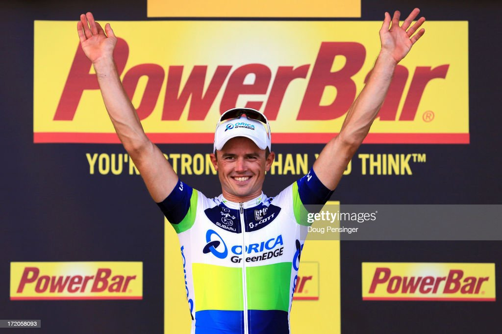 <a gi-track='captionPersonalityLinkClicked' href=/galleries/search?phrase=Simon+Gerrans&family=editorial&specificpeople=750380 ng-click='$event.stopPropagation()'>Simon Gerrans</a> of Australia riding for Orica GreenEdge takes to the podium after winning stage three of the 2013 Tour de France, a 145.5KM road stage from Ajaccio to Calvi, on July 1, 2013 in Calvi, France. The 100th edition of Le Tour de France commences on the island of Corsica and ends July 21 in Paris.