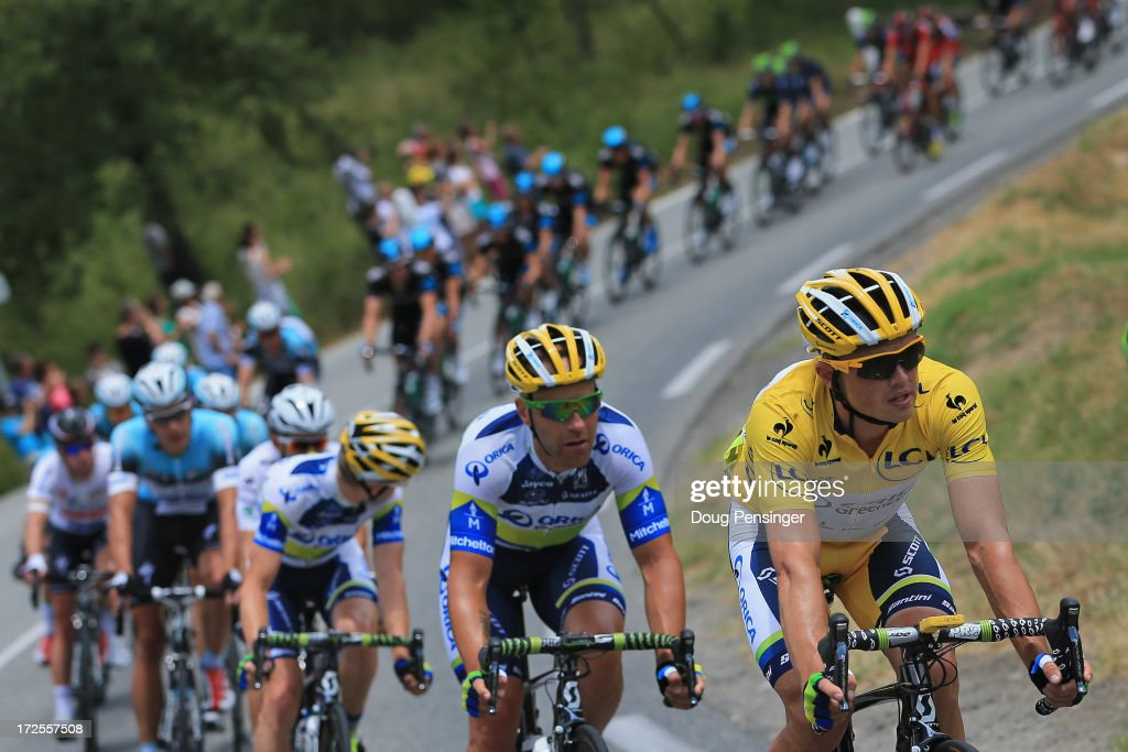 <a gi-track='captionPersonalityLinkClicked' href=/galleries/search?phrase=Simon+Gerrans&family=editorial&specificpeople=750380 ng-click='$event.stopPropagation()'>Simon Gerrans</a> of Australia riding for Orica-GreenEdge rides in the peloton as he successfully defends the overall race leader's yellow jersey during stage five of the 2013 Tour de France, a 228.5KM road stage from Cagnes-sur-mer to Marseille, on July 3, 2013 in Lorgues, France.