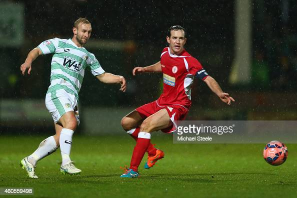 Simon Gillett of Yeovil watched by Luke Joyce of Accrington during the FA Cup Second Round Replay match between Yeovil Town and Accrington Stanley at...