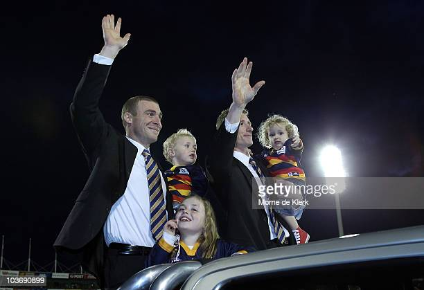 Simon Goodwin and Brett Burton of the Crows during a lap of honour after the round 22 AFL match between the Adelaide Crows and the St Kilda Saints at...