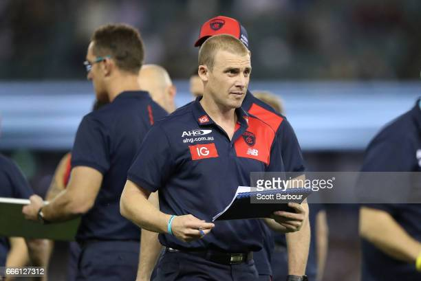 Simon Goodwin coach of the Demons speaks to his team during a quarter time break during the round three AFL match between the Geelong Cats and the...