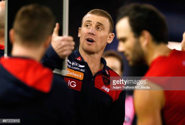 Simon Goodwin Senior Coach of the Demons addresses his players during the 2017 AFL round 13 match between the Western Bulldogs and the Melbourne...