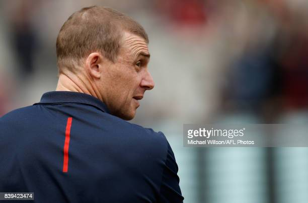 Simon Goodwin Senior Coach of the Demons looks on during the 2017 AFL round 23 match between the Collingwood Magpies and the Melbourne Demons at the...
