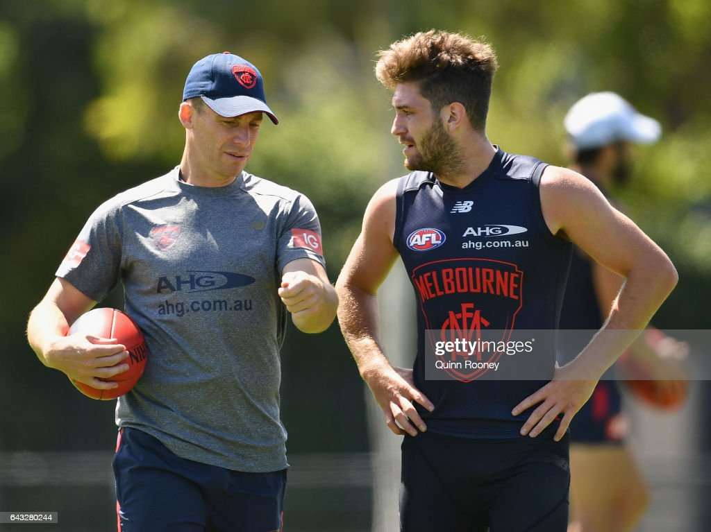 Simon Goodwin the coach of the Demons talks to Tomas Bugg of the Demons during a Melbourne Demons AFL training session on February 21, 2017 in Melbourne, Australia.