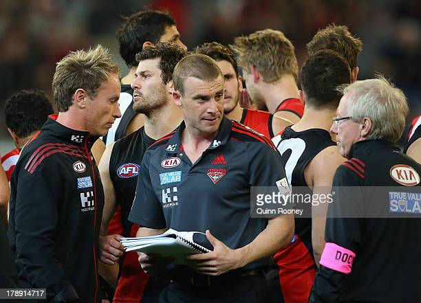 Simon Goodwin the stand in coach for the Bombers talks to his players during the round 23 AFL match between the Essendon Bombers and the Richmond...