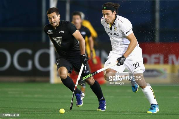 Simon Gougnard of Belgium and Nick Ross of New Zealand battle for possession during the Quarter final match between Belgium and New Zealand during...