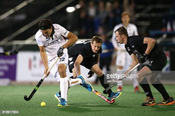 Simon Gougnard of Belgium controls the ball from Hugo Inglis and Hayden Phillips of New Zealand during day 6 of the FIH Hockey World League Men's...