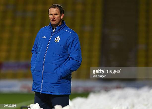 Simon Grayson Manager of Huddersfield Town looks on during the npower Championship match between Watford and Huddersfield Town at Vicarage Road on...