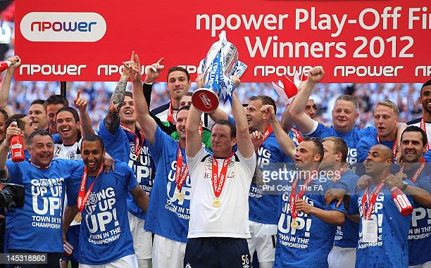 Simon Grayson Manager of Huddersfield Townlifts the Trophy after winning the npower League One playoff Final between Huddersfield Town and Sheffield...