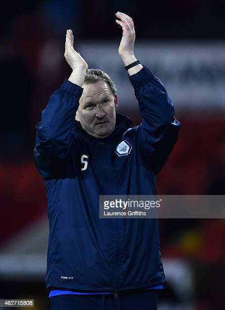 Simon Grayson of Preston North End applauds the fans after victory in the FA Cup Fourth Round Replay match between Shefield United and Preston North...