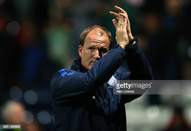 Simon Grayson the manager of Preston North End applauds his supporters after the Capital One Cup Second Round match between Preston North End and...