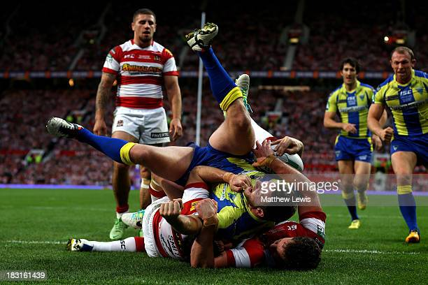 Simon Grix of Warrington crashes through the Wigan defence to score his team'ssecond try during the Super League Grand Final between Warrington...
