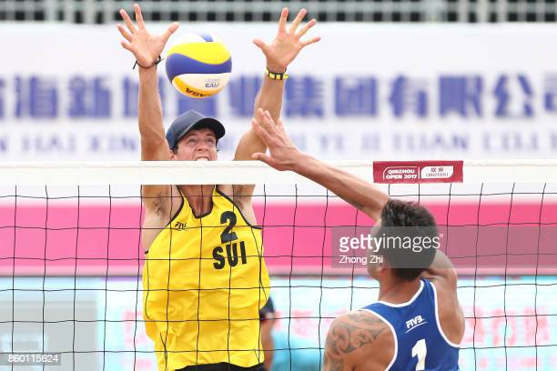 Simon Hagenbuch of Switzerland in action with Quentin Metral of Switzerland during the qualification match of 2017 FIVB Beach Volleyball Qinzhou Open...