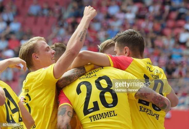Simon Hedlund Christopher Trimmel and Damir Kreilach of 1 FC Union Berlin celebrate after scoring the 01 during the game between FC Ingolstadt and...