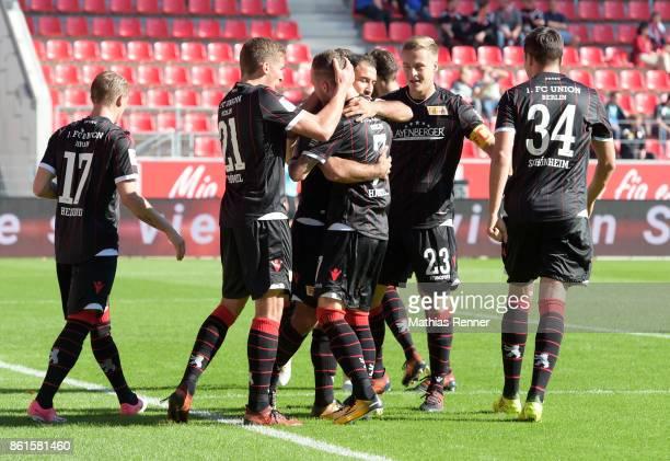 Simon Hedlund Grischa Proemel Marcel Hartel Akaki Gogia Felix Kroos and Fabian Schoenheim of 1 FC Union Berlin celebrate after scoring the 01 during...