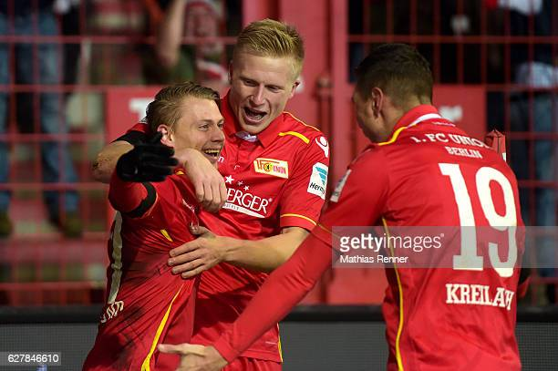 Simon Hedlund Kristian Pedersen and Damir Kreilach of 1 FC Union Berlin celebrate after scoring the 10 during the game between dem 1 FC Union Berlin...