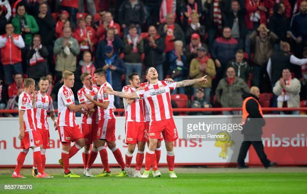 Simon Hedlund Marcel Hartel Felix Kroos Grischa Proemel Fabian Schoenheim Steven Skrzybski and Sebastian Polter of 1FC Union Berlin celebrate after...