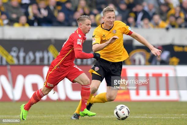Simon Hedlund of 1 FC Union Berlin and Marco Hartmann of SG Dynamo Dresden during the game between SG Dynamo Dresden and dem 1 FC Union Berlin on...