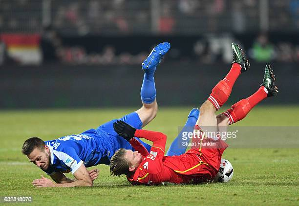 Simon Hedlund of Berlin is challenged by Marco Stiepermann of Bochum during the Second Bundesliga match between 1 FC Union Berlin and VfL Bochum 1848...