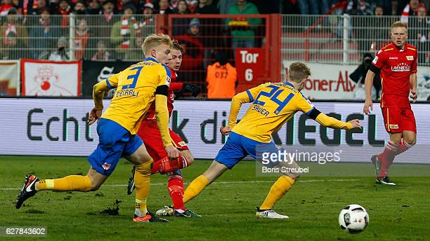 Simon Hedlund of Union Berlin scores his team's first goal during the Second Bundesliga match between 1 FC Union Berlin and Eintracht Braunschweig at...