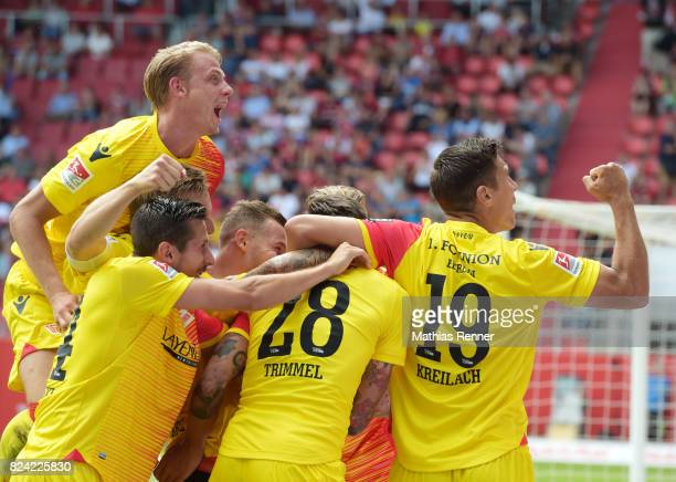 Simon Hedlund Steven Skrzybski Marcel Hartel Christopher Trimmel and Damir Kreilach of 1 FC Union Berlin celebrate after scoring the 01 during the...