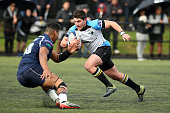 Simon Hickey of Grammar TEC heads for the try line defended by Loketi Manu of College rifles during the match between College Rifles and Grammar TEC...