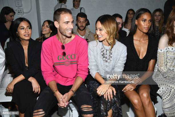 Simon Huck and Jamie Chung attend the Jonathan Simkhai fashion show during New York Fashion Week The Shows at Gallery 1 Skylight Clarkson Sq on...
