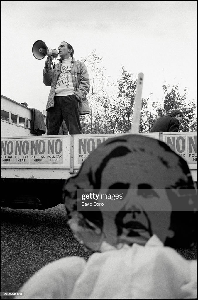 Simon Hughes MP above an image of Margaret Thatcher during a Poll Tax demonstration on Market Road, London, N7 , UK, 5th November 1989.