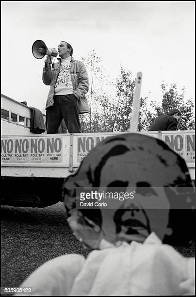 Simon Hughes MP above an image of Margaret Thatcher during a Poll Tax demonstration on Market Road London N7 UK 5th November 1989