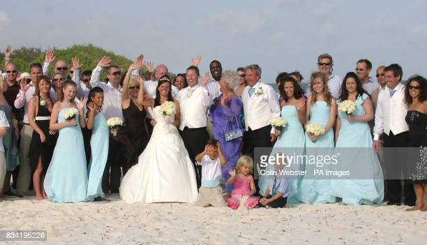 Simon James and Nicola Hallahan toast their wedding in Kenya with friends and relatives
