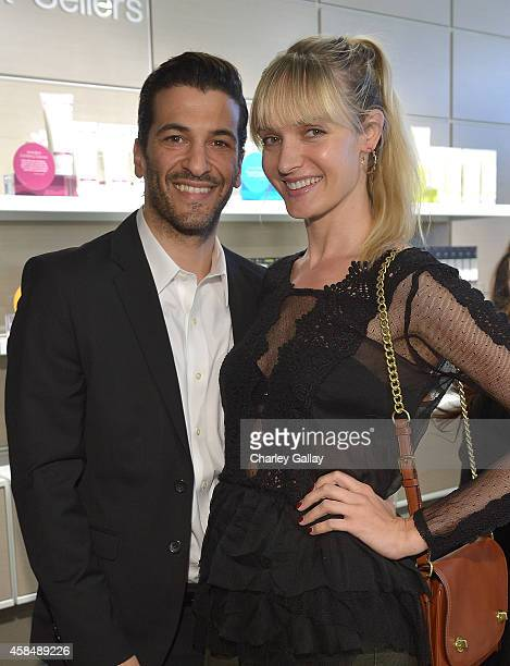 Simon Kassianides and Galina Hollechek attend the Murad LA Flagship Store Grand Opening on November 5 2014 in Los Angeles California