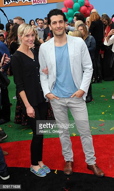 Simon Kassianides and guest arrive for the Premiere Of Sony Pictures' 'Angry Birds' held at Regency Village Theatre on May 7 2016 in Westwood...