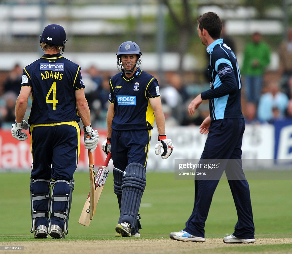 Simon Katich and James Adams of Hampshire Royals after victory in the Clydesdale Bank Pro40 semi final match between Sussex and Hampshire at the Probiz County Ground on September 1, 2012 in Hove, England.