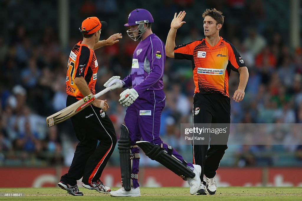 <a gi-track='captionPersonalityLinkClicked' href=/galleries/search?phrase=Simon+Katich&family=editorial&specificpeople=176577 ng-click='$event.stopPropagation()'>Simon Katich</a> and Mitch Marsh of the Scorchers celebrate the wicket of Ben Dunk of the Hurricanes during the Big Bash League match between the Perth Scorchers and the Hobart Hurricanes at WACA on January 7, 2014 in Perth, Australia.