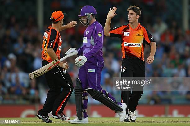 Simon Katich and Mitch Marsh of the Scorchers celebrate the wicket of Ben Dunk of the Hurricanes during the Big Bash League match between the Perth...