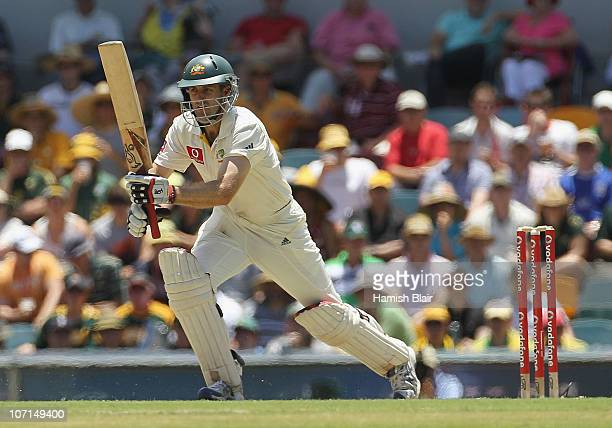 Simon Katich of Australia drives during day two of the First Ashes Test match between Australia and England at The Gabba on November 26 2010 in...