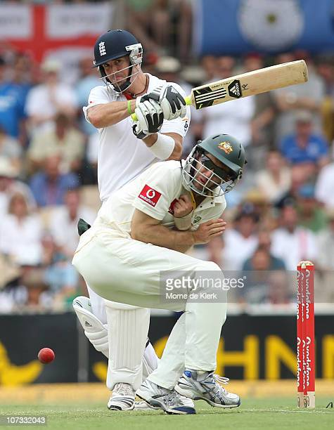 Simon Katich of Australia ducks for cover as Kevin Pietersen of England bats during day three of the Second Ashes Test match between Australia and...
