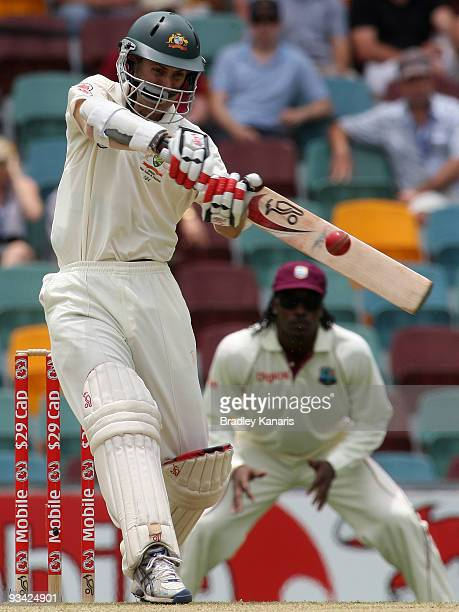 Simon Katich of Australia hits the ball over the bounday for a six during day one of the First Test match between Australia and the West Indies at...
