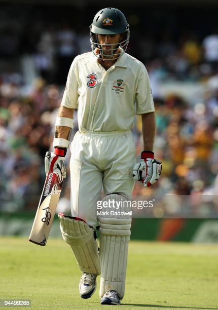 Simon Katich of Australia leaves the ground after being dismissed by Sulieman Benn of the West Indies for 99 runs during day one of the Third Test...