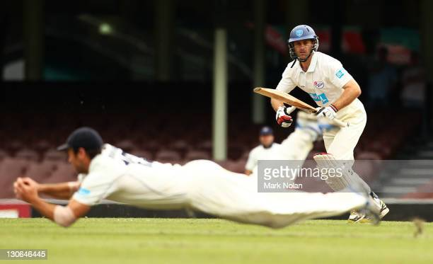 Simon Katich of the Blues watches on as a Bushranger fields during day four of the Shieffield Shield match between the New South Wales Blues and the...