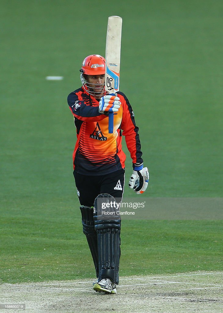 Simon Katich of the Scorchers raises his bat after he scored his half century during the Big Bash League match between the Hobart Hurricanes and the Perth Scorchers at Blundstone Arena on January 1, 2013 in Hobart, Australia.