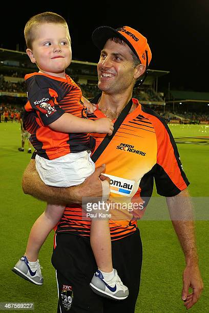 Simon Katich of the Scorchers walks a celebration lap of the field with his son Xavier after winning the Big Bash League Final match between the...