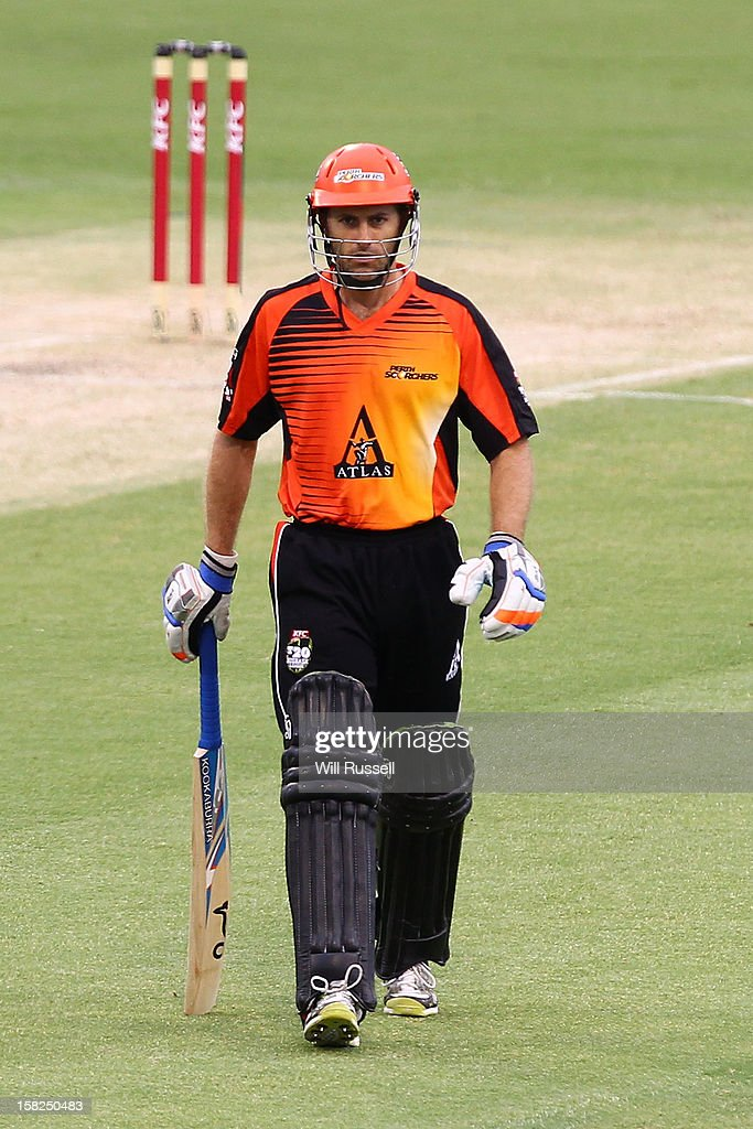 Simon Katich of the Scorchers walks away from the wicket after being caught by David Hussey during the Big Bash League match between the Perth Scorchers and the Melbourne Stars at WACA on December 12, 2012 in Perth, Australia.