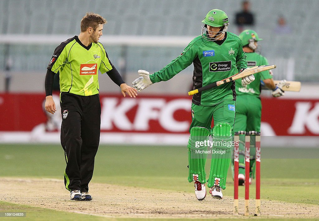 Simon Keen (L) of the Sydney Thunder is forgiven by David Hussey of the Melbourne Stars for bowling a dangerous full toss during the Big Bash League match between the Melbourne Stars and the Sydney Thunder at Melbourne Cricket Ground on January 8, 2013 in Melbourne, Australia.