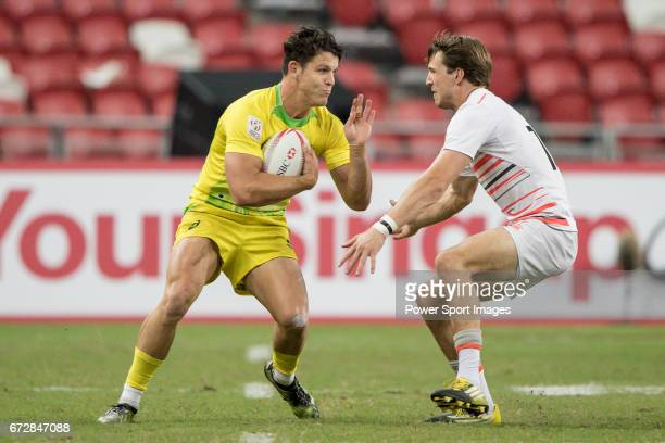 Simon Kennewell of Australia competes for the ball with Harry Glover of England during the match Australia vs England the Bronze Final of Day 2 of...