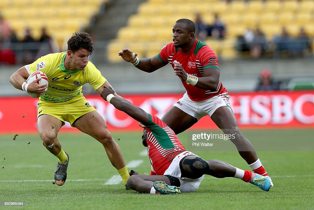 Simon Kennewell of Australia is tackled during the Trophy final against Kenya during the 2017 Wellington Sevens at Westpac Stadium on January 29, 2017 in Wellington, New Zealand.