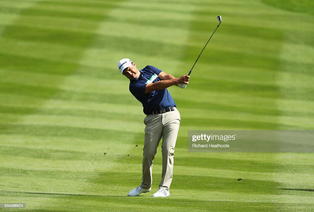 <a gi-track='captionPersonalityLinkClicked' href=/galleries/search?phrase=Simon+Khan&family=editorial&specificpeople=215124 ng-click='$event.stopPropagation()'>Simon Khan</a> of England hits his 2nd shot on the 4th hole during day one of the BMW PGA Championship at Wentworth on May 26, 2016 in Virginia Water, England.