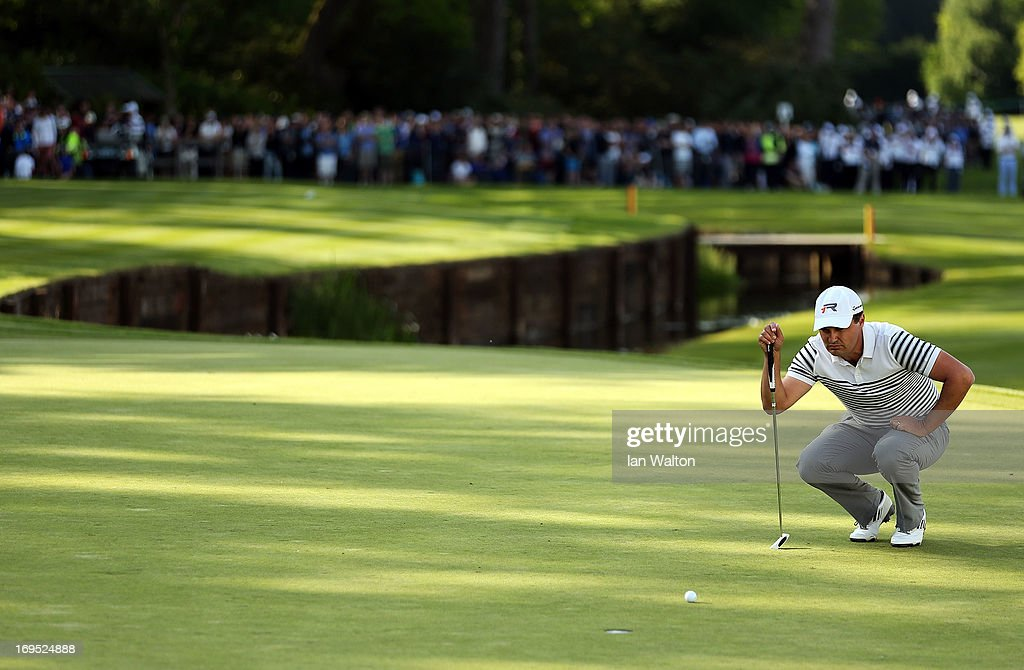 Simon Khan of England lines up a putt on the eighteenth green in the play-off during the final round of the BMW PGA Championship on the West Course at Wentworth on May 26, 2013 in Virginia Water, England.