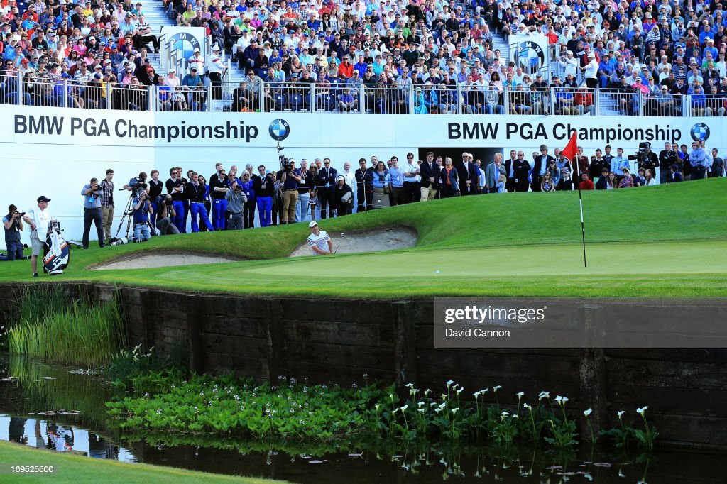 Simon Khan of England plays from a bunker on the eighteenth green in the third play-off hole during the final round of the BMW PGA Championship on the West Course at Wentworth on May 26, 2013 in Virginia Water, England.